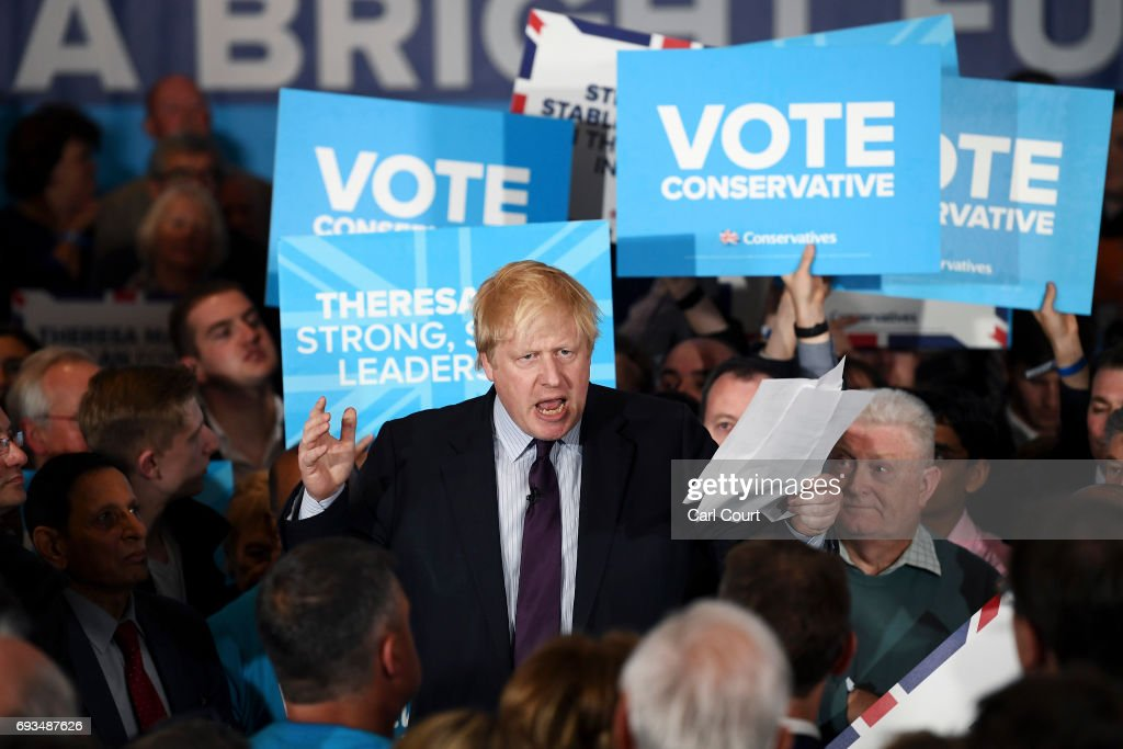 British Foreign Secretary Boris Johnson speaks ahead of Prime Minister Theresa May during her last campaign visit at the National Conference Centre on June 7, 2017 in Solihull, United Kingdom. Britain goes to the polls tomorrow to vote in a general election.