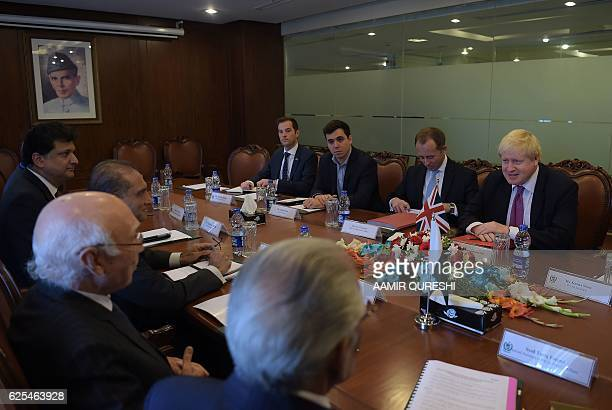 British Foreign Secretary Boris Johnson speaks with Pakistan's National Security Advisor Sartaj Aziz during their meeting at the Foreign Ministry in...