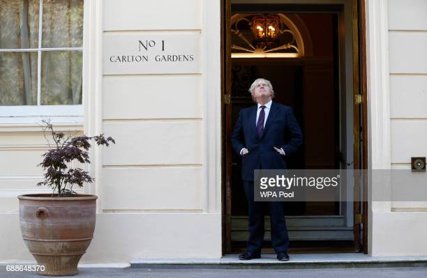 British Foreign Secretary Boris Johnson waits to greet US secretary of state Rex Tillerson outside Carlton Gardens on May 26 2017 in London England...