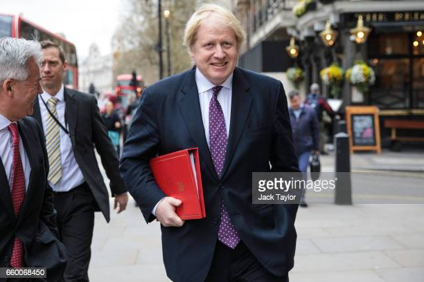 British Foreign Secretary Boris Johnson walks down Whitehall on March 29 2017 in London England Today British Prime Minister Theresa May addresses...