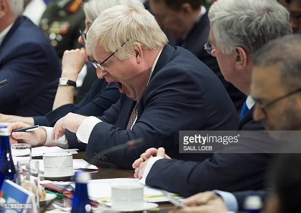 British Foreign Secretary Boris Johnson yawns as he attends a meeting of the Ministers of the Global Coalition to Counter ISIL at the State...