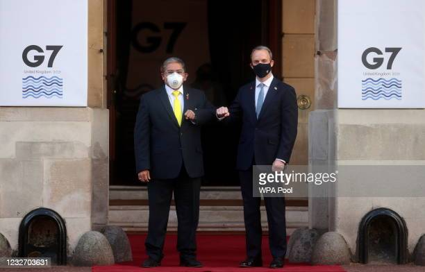British Foreign Secretary Dominic Raab bumps elbows with his Brunei counterpart Erywan Yusof ahead of the G7 Foreign and Development Ministers at...