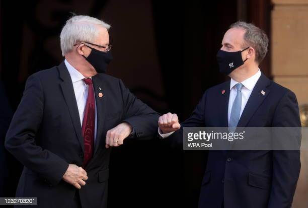 British Foreign Secretary Dominic Raab bumps elbows with his Canadian counterpart Marc Garneau ahead of the G7 Foreign and Development Ministers at...