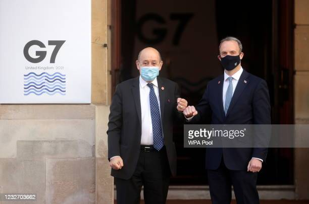 British Foreign Secretary Dominic Raab bumps fists with his French counterpart Jean-Yves Le Drian ahead of the G7 Foreign and Development Ministers...