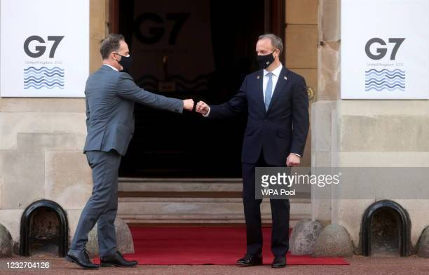 British Foreign Secretary Dominic Raab bumps fists with his German counterpart Heiko Maas ahead of the G7 Foreign and Development Ministers at...