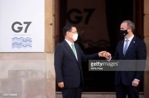 British Foreign Secretary Dominic Raab bumps fists with his South Korean counterpart Chung Eui-yong ahead of the G7 Foreign and Development Ministers...