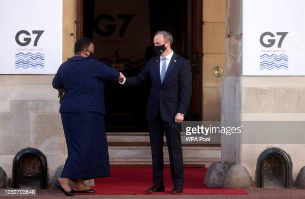 British Foreign Secretary Dominic Raab bumps fists with his South African counterpart Naledi Pandor ahead of the G7 Foreign and Development Ministers...