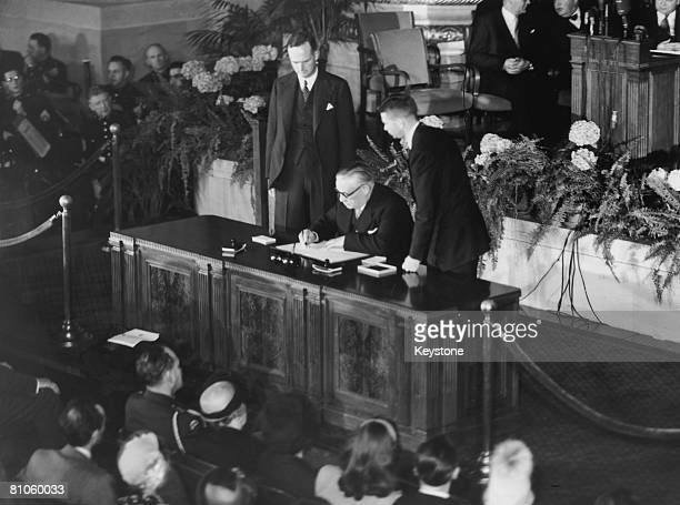 British Foreign Secretary Ernest Bevin signs the North Atlantic Treaty in Washington while Sir Oliver Franks British Ambassador to the United States...