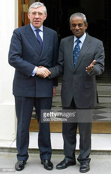 British foreign secretary Jack Straw greets Singapore Foreign Affairs Minister S. Jayakumar, at Carlton Gardens in London 15 April 2004. S. Jayakumar...