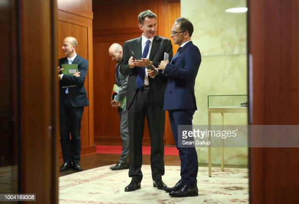 British Foreign Secretary Jeremy Hunt and German Foreign Minister Heiko Maas chat before addressing the media at the Foreign Ministry on July 23 2018...