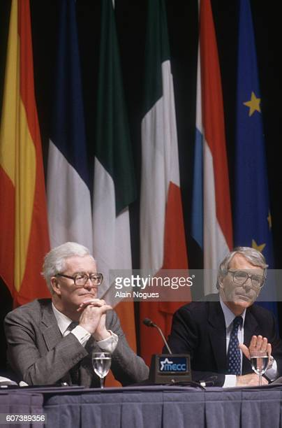 British Foreign Secretary John Hurd and Prime Minister John Major listen to proceedings during the second day of the Maastricht Summit conference....
