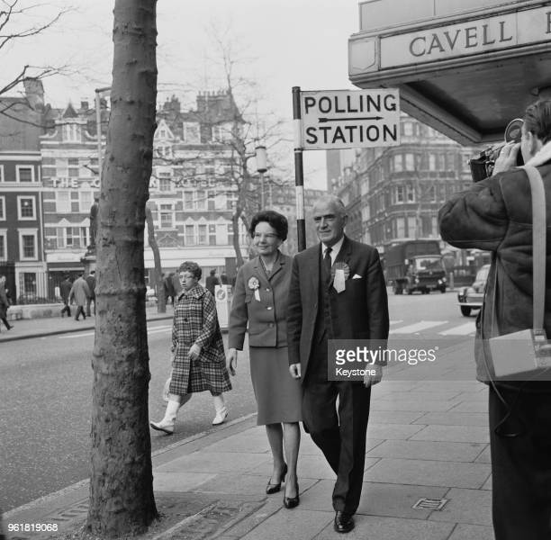 British Foreign Secretary Michael Stewart and his wife Mary arrive at the polling station at Cavell House Charing Cross Road London to cast their...