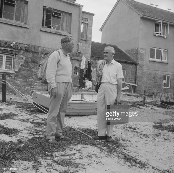 British Foreign Secretary Michael Stewart meets British Prime Minister Harold Wilson on the Scilly Isles where both are spending their holiday 12th...