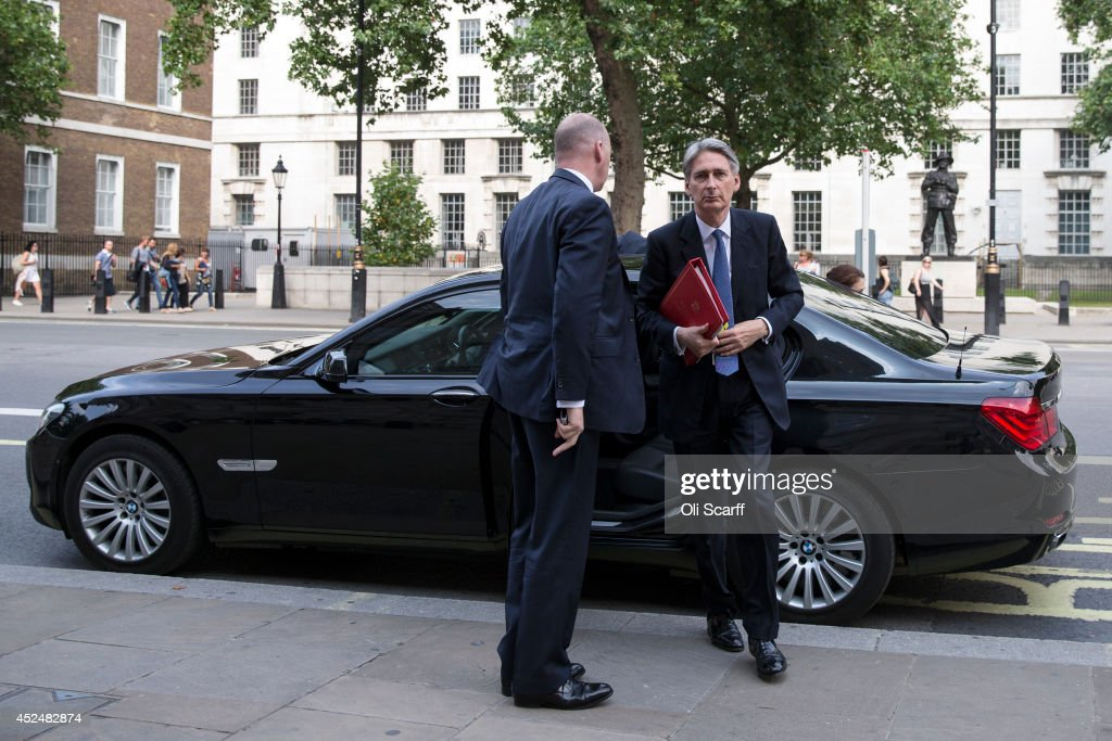 British Foreign Secretary Philip Hammond (R) arrives at the Cabinet Office on July 21, 2014 in London, England. British Prime Minster David Cameron is holding a National Security and COBRA meeting today to discuss developments on the crash of the Malaysian Airlines flight MH17.