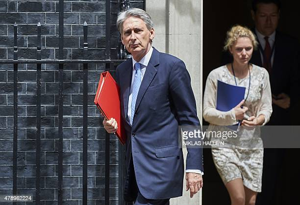 British Foreign Secretary Philip Hammond leaves Downing street on June 29 2015 in London British Prime Minister David Camerom will make a statement...