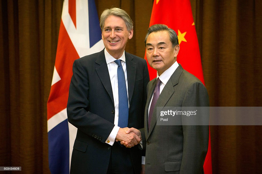 British Foreign Secretary Philip Hammond, left, shakes hands with Chinese Foreign Minister Wang Yi, right, as he arrives for a meeting at the Ministry of Foreign Affairs on January 5, 2016 in Beijing, China.