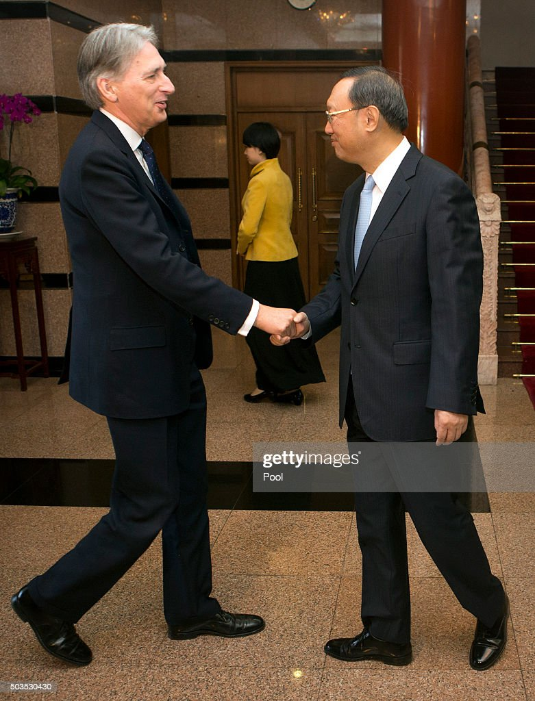British Foreign Secretary Philip Hammond, left, shakes hands with Chinese State Councilor Yang Jiechi, right, as he arrives for a meeting, January 6, 2016 at the Diaoyutai State Guesthouse in Beijing, China.