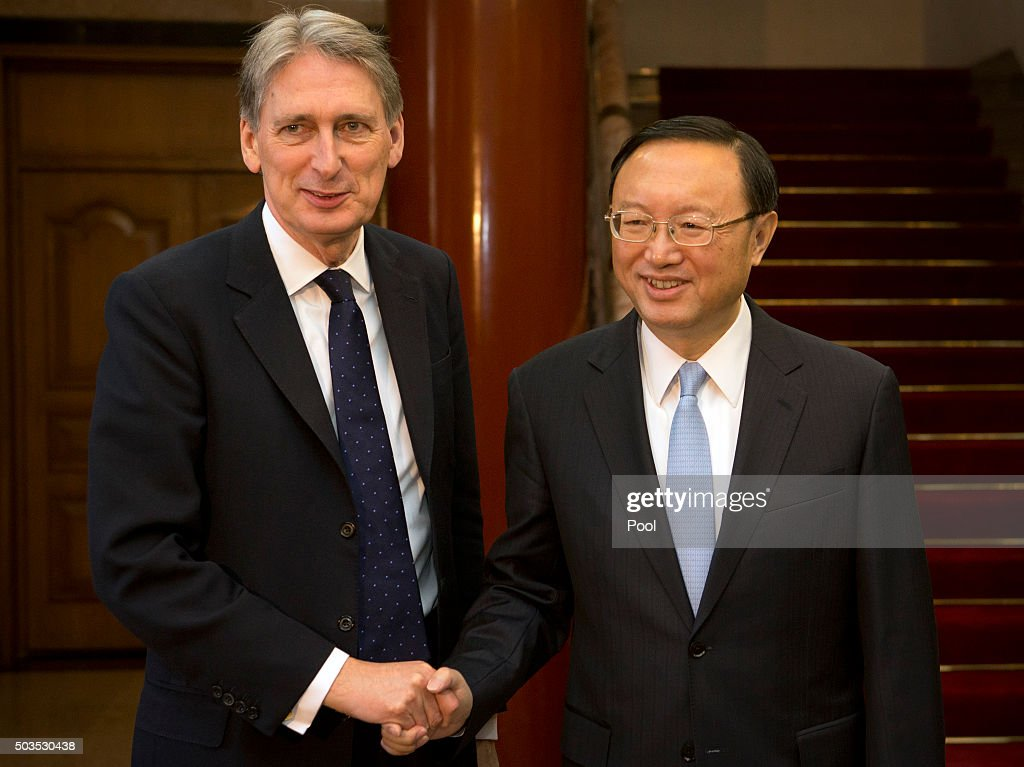 British Foreign Secretary Philip Hammond, left, shakes hands with Chinese State Councilor Yang Jiechi, right, as he arrives for a meeting at the Diaoyutai State Guesthouse January 6, 2016 at the Diaoyutai State Guesthouse in Beijing, China.