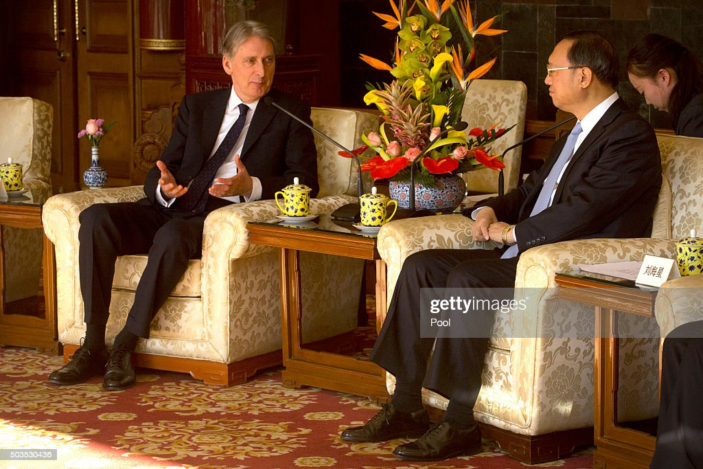 British Foreign Secretary Philip Hammond, left, speaks during a meeting with Chinese State Councilor Yang Jiechi, right, at the Diaoyutai State Guesthouse January 6, 2016 at the Diaoyutai State Guesthouse in Beijing, China.