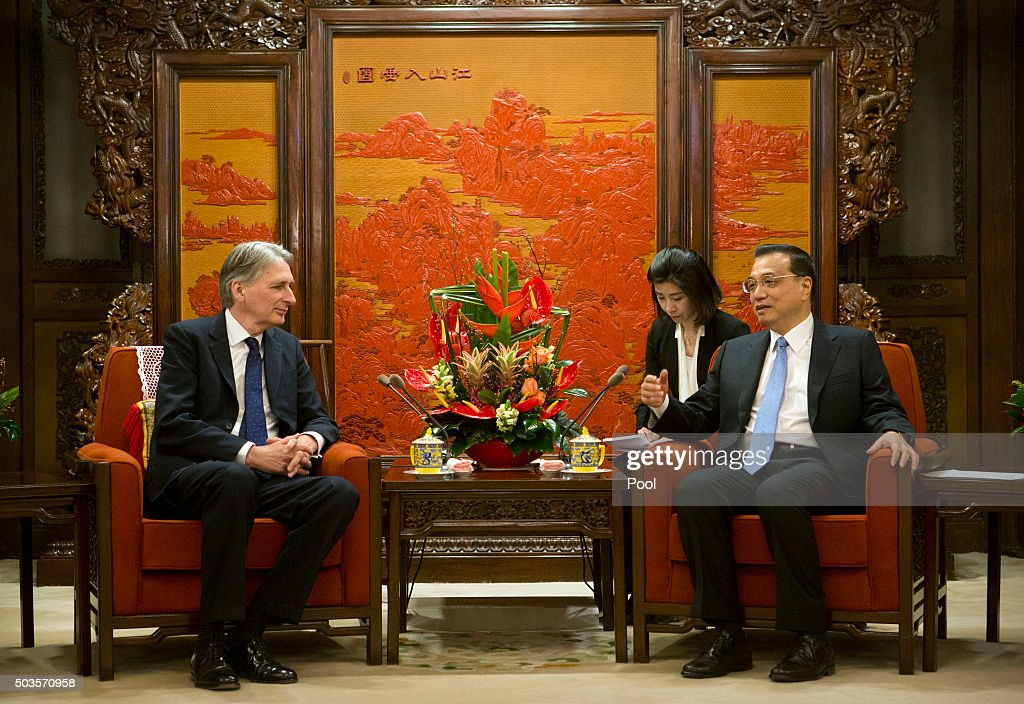 British Foreign Secretary Philip Hammond listens to Chinese Premier Li Keqiang (R) during a meeting at the Zhongnanhai Leadership Compound on January 6, 2016 at the Diaoyutai State Guesthouse in Beijing, China.