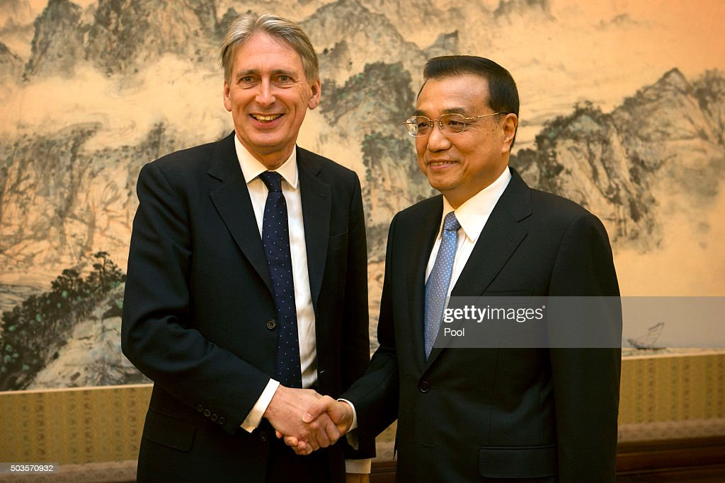 British Foreign Secretary Philip Hammond shakes hands with Chinese Premier Li Keqiang (R) as he arrives for a meeting at the Zhongnanhai Leadership Compound on January 6, 2016 at the Diaoyutai State Guesthouse in Beijing, China.
