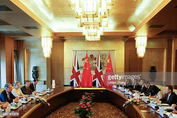 British Foreign Secretary Philip Hammond speaks with Chinese State Councilor Yang Jiechi during the ChinaUK Strategic Dialogue at the Diaoyutai State...