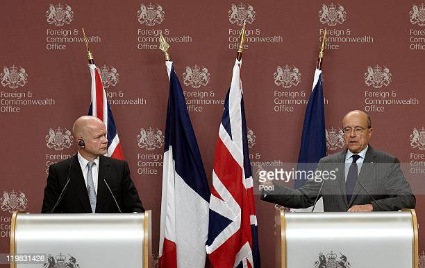 British Foreign Secretary William Hague and French Minister of Foreign and European Affairs Alain Juppe address the media during their joint press...
