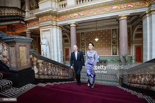 British Foreign Secretary William Hague greets Myanmar's opposition leader Aung San Suu Kyi at the Foreign office on October 23 2013 in London...