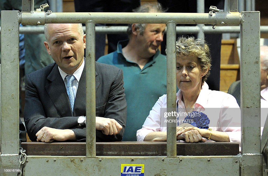 British Foreign Secretary William Hague (L) looks during a cattle auction at the Thirsk rural business centre in Thirsk, north Yorkshire, England on May 20, 2010, Hague was in the region to vist Conservative councillor Anne McIntosh (R) who is standing in the Malton and Thirsk local elections.