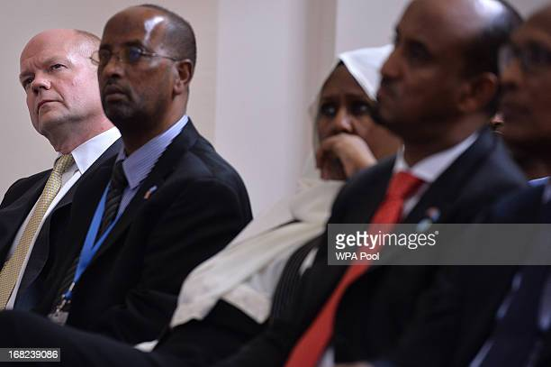 British Foreign Secretary William Hague looks on as he sits amongst delegates during a press conference given by Somali President Hassan Sheikh...