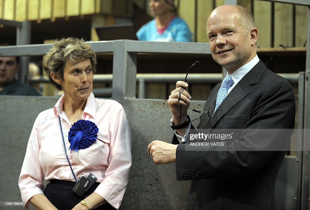British Foreign Secretary William Hague (R) speaks to farmers at the Thirsk rural business centre in Thirsk, north Yorkshire, England on May 20, 2010, Hague was in the region to vist Conservative councillor Anne McIntosh (L) who is standing in the Malton and Thirsk local elections.