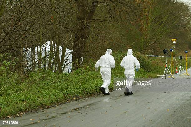 British forensic police work at a crime scene in Levington near Ipswich in Suffolk 13 December 2006 after the bodies of two more prostitutes were...