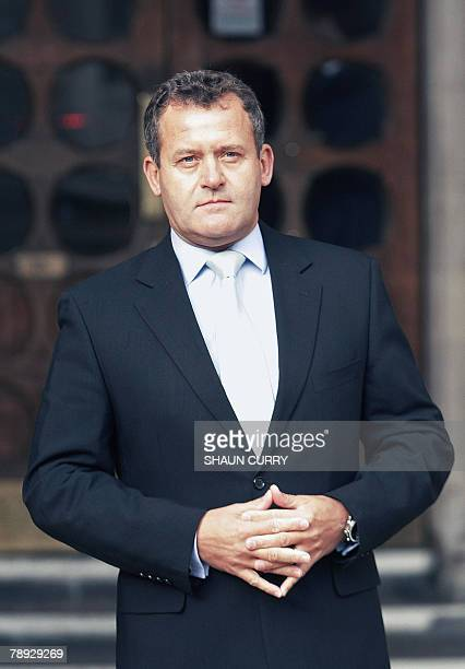 British former butler Paul Burrell poses for the media outside London's High Court in central London 14 January 2008 during the inquest into the...