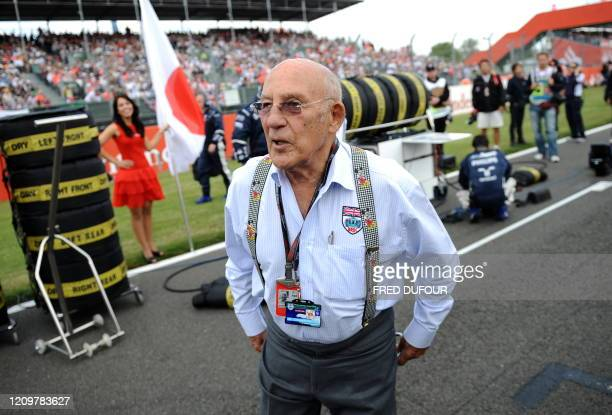 British former driver Sir Stirling Moss is pictured on the grid of the Silverstone circuit on June 21 2009 in Silverstone before the start of the...