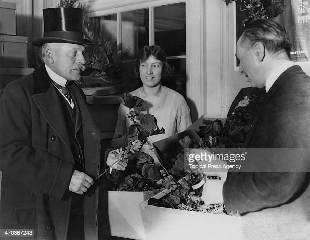 British former Field Marshal Douglas Haig, 1st Earl Haig inspects poppies, ready for sale before Armistice Day, October 1922. Haig founded the Haig...
