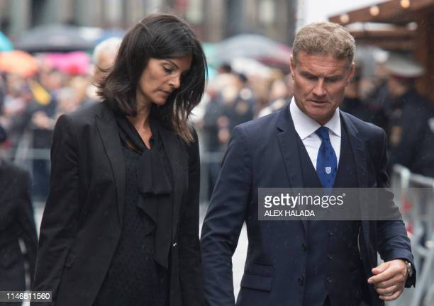 British former Formula One racing driver David Coulthard and his wife Karen Minier arrive to attend the funeral ceremony for late Austrian three-time...