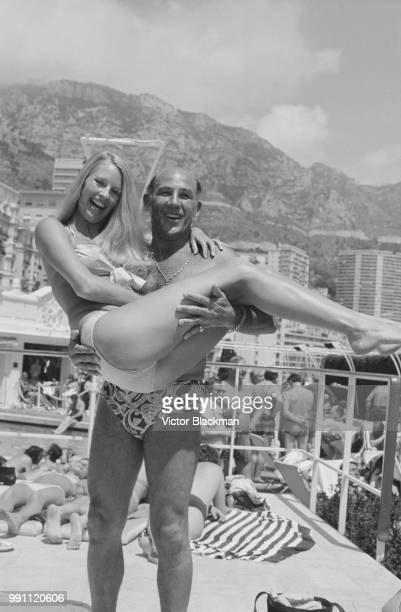 British former Formula One racing driver Stirling Moss on holiday in Monaco with fashion model Liz Hooley 5th June 1973