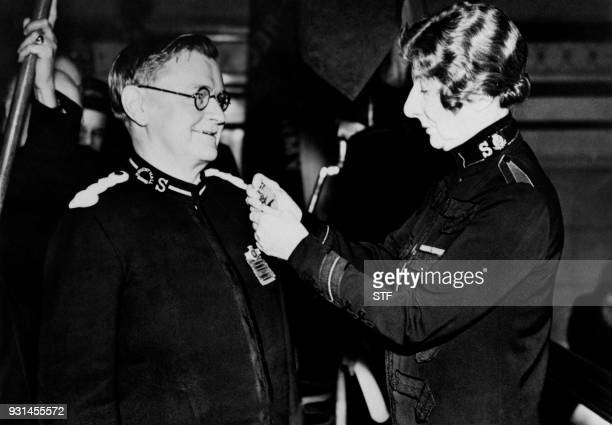 British former General of the Salvation Army Evangeline Booth awards conductor Herbert Twitchin with the Order of the Founder on October 29 1939 in...