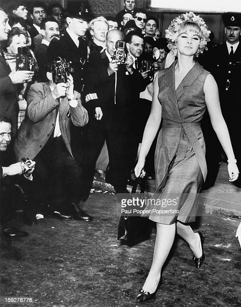 British former model and showgirl Mandy RiceDavies leaves the Old Bailey London after giving evidence in the trial of Stephen Ward July 1963 Ward is...