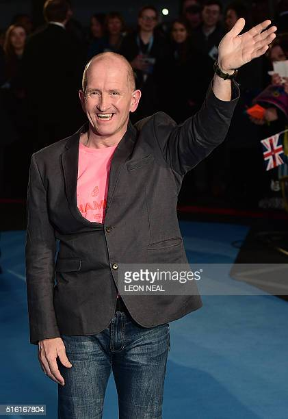 British former Olympic ski jumper Eddie 'the eagle' Edwards poses for a photograph as he arrives for the European premiere of Eddie The Eagle in...