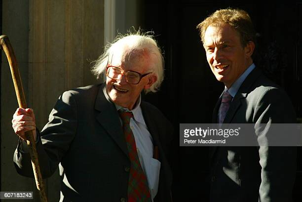 British former politician and Labour Party leader Michael Foot and British Prime Minister Tony Blair wave outside 10 Downing Street London England...