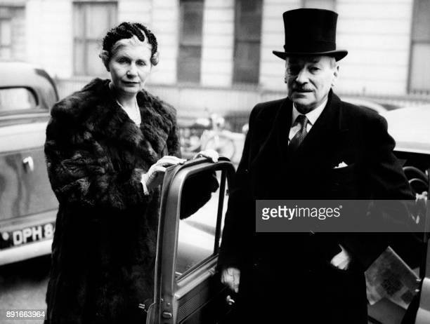 British former Prime Minister Clement Attlee accompanied by his wife Violet arrives at Courtfield Gardens in London for his formal introduction to...