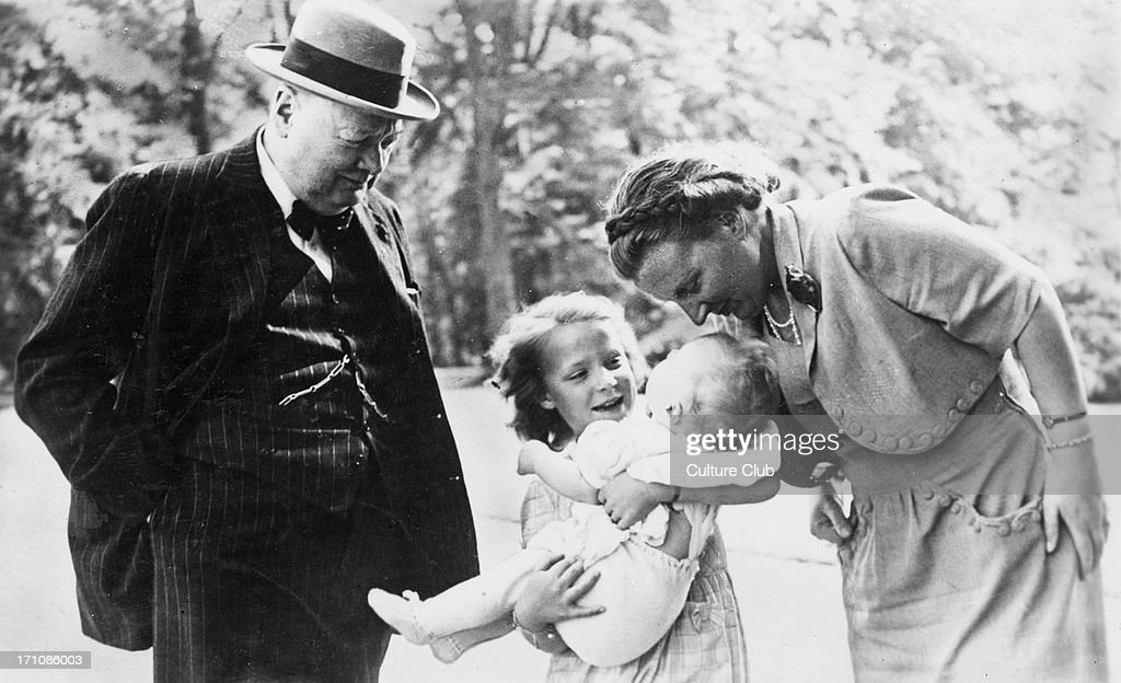 British former Prime Minister Winston Churchill (1874 - 1965) and Queen Juliana of the Netherlands (1909 - 2004) look on as Juliana's daughter Irene holds her baby sister Marijke, in the grounds of Soestdijk Palace, Utrecht, Netherlands, 8th May 1948. Marijke, who was later known by her second name, Christina, was Churchill's goddaughter. Churchill is in the Netherlands to attend the Hague Congress.
