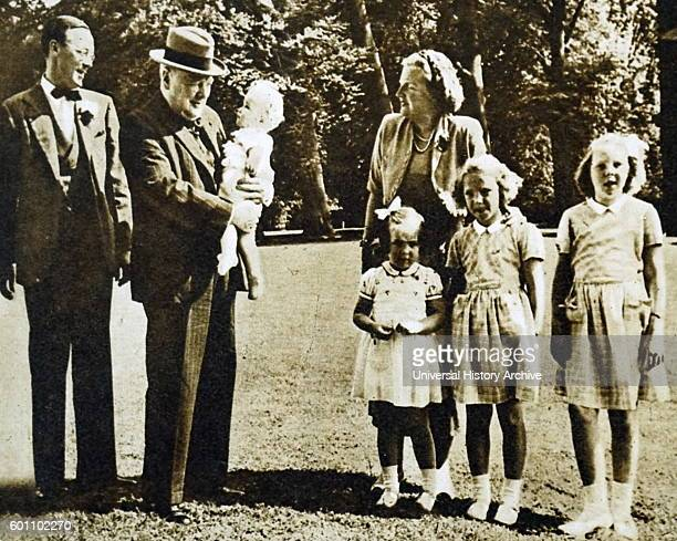 British former Prime Minister Winston Churchill holds his goddaughter Marijke in the grounds of Soestdijk Palace, during a visit to the Dutch Royal...