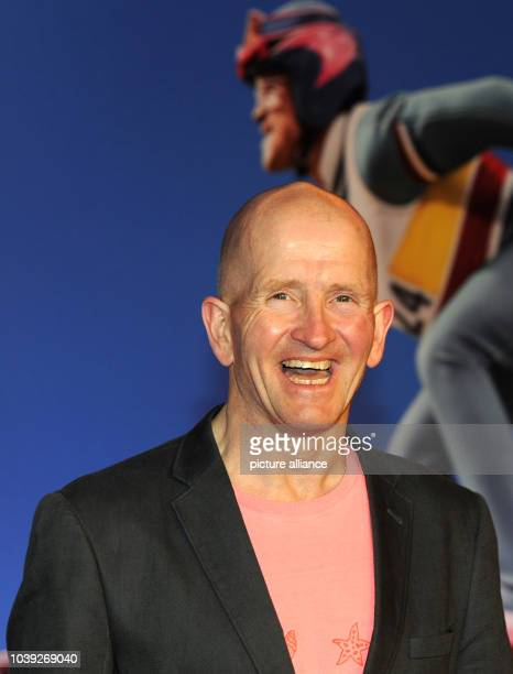 British former ski jumper Eddie 'The Eagle' Edwards poses as he arrives for a special screening of 'Eddie The Eagle' in Munich Germany 20 March 2016...