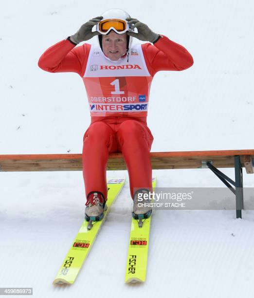 British former ski jumper Michael Edwards known as Eddie The Eagle prepares for a fun jump during the FourHillsTournament in Oberstdorf southern...
