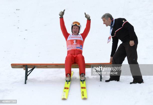 British former ski jumper Michael Edwards known as Eddie The Eagle reacts at the FourHillsTournament in Oberstdorf southern Germany on December 29...
