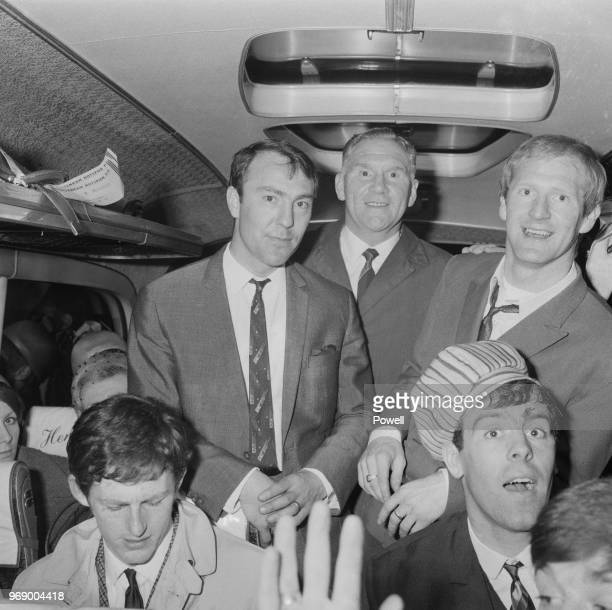 British former soccer player and manager Bill Nicholson with Tottenham Hotspur FC players Jimmy Greaves Frank Saul and Pat Jennings travelling on a...