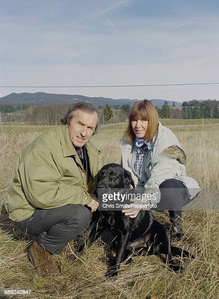 British former three time Formula One world champion racing driver Jackie Stewart pictured with his wife Helen Stewart and pet Labrador dog in the...