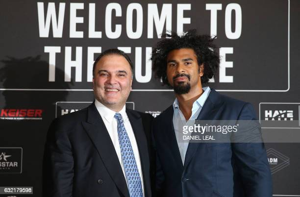 British former world heavyweight boxing champion David Haye poses with promoter Richard Schaefer during a press conference announcing a deal with to...